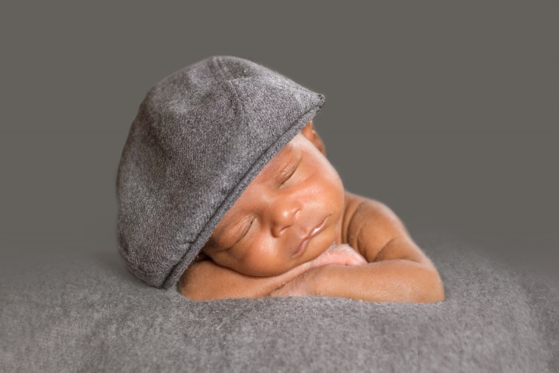 Newborn Baby Boy with a hat on.