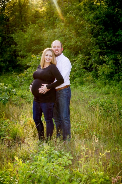 Pregnancy Photography Toledo Ohio in a field at sunset